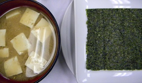 miso soup and a sheet of nori awaiting fillings