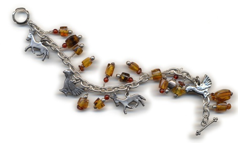 charm bracelet using Mexican amber & silver charms