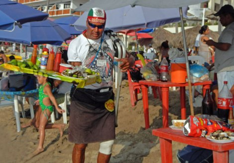 Johnny selling oysters on the beach in PV
