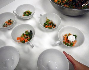 vegetable Brunoise in the bottom of the individual soup bowls - the bowl on the far right already has a quail egg placed and is now ready for the soup stock