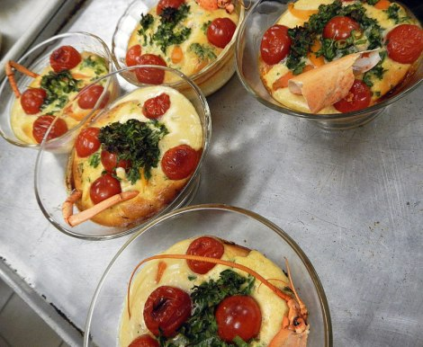 the Seafood Clafoutis (custard mix) is poured over the seafood, and topped with cherry tomatoes and basil