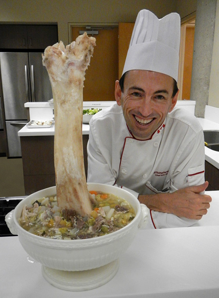 Chef Eric poses besides the Wooden Leg Soup