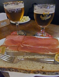 the beers and traditional bread slab with ham