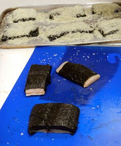 pre-wrapping the fish in seaweed before covering with rock salt...