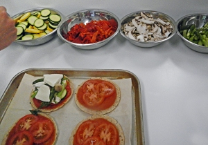 the crisped pita breads were layered with tomato sauce, then topped with all sorts of vegetables