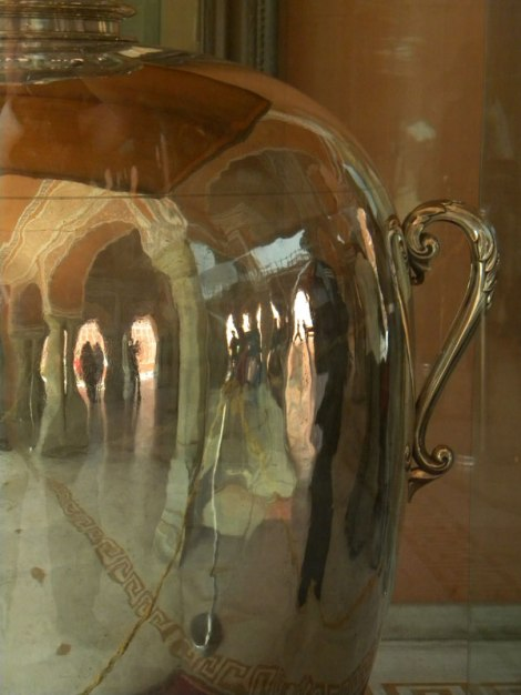 reflection of Jaipur Palace in large silver jar