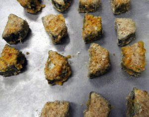 each piece was coated with egg, crushed hazelnuts, flour and breadcrumbs