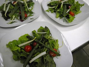 the salad of mixed greens, pear, tomato, and blanched asparagus