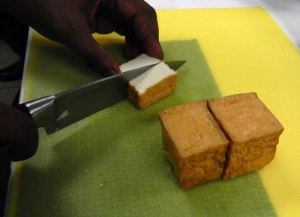 slicing the tofu for our Cambodian coconut curry