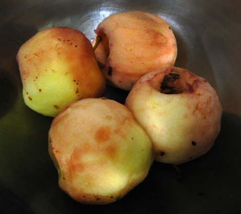 spiced cored apples poached and removed from the wine
