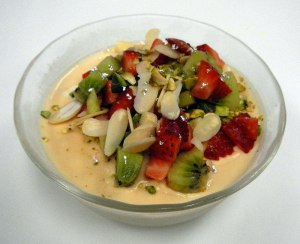 Kulfi with almonds, pistachios, strawberries and kiwis, dusted with edible silver