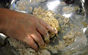 Water and a small amount of oil is added in until the dough is soft