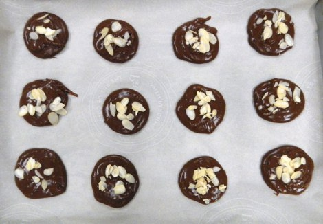 chocolate choux pastry sprinkled with flaked almonds ready to go into the oven