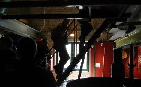 climbing the stairs at 'De Halve Maan Brouwerij' tour