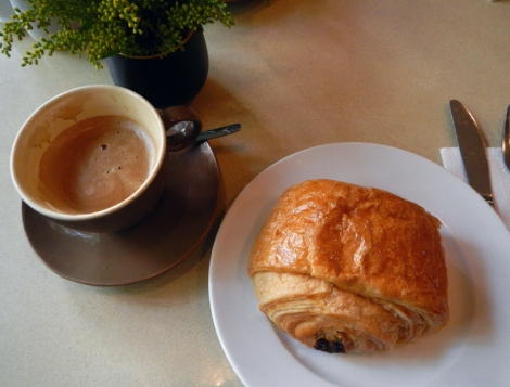 in Hanoi, a pan au chocolate with Vietnamese French-roast coffee