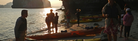 Landing our Kayaks on a Beach in Halong Bay at Sunset