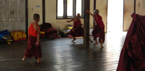 Inle Lake monastery with young monks running