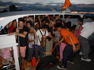 overcrowded boat at Bangkok's Loy Krathong Festival