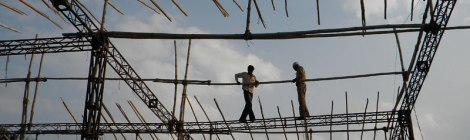 Workers up on a scaffolding in Udaipur, India