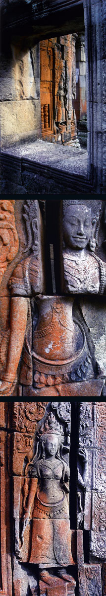 Angkor Wat stone apsara covered with rust-coloured lichen