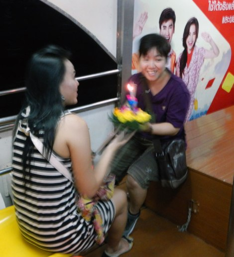 a small floating lantern launch from our ferry during Loi Krathong