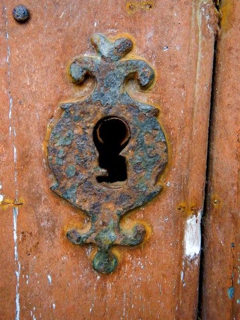 The key hole exhaled a moldy breath