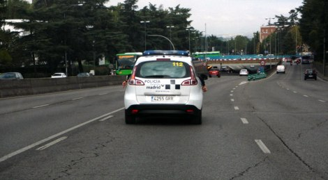 Our cheery police escort out of Madrid!