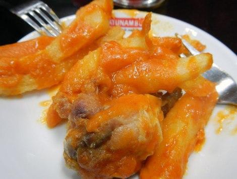 Tapa of Chicken Leg and Patatas Bravas