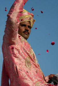 Raja riding an elephant being showered by rose petals at the Elephant Festival in Jaipur