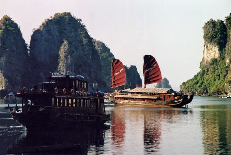 Junk with red sails in Halong Bay in Vietnam