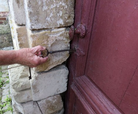 The Caretaker opens up the door to the old church on the way to Rouen in France