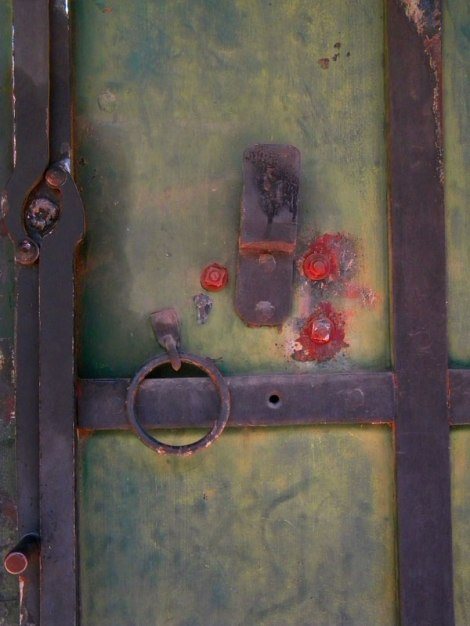 Green door with rust in Columbia, California
