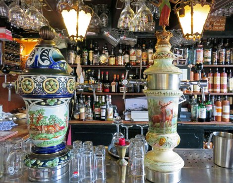 The ceramic beer taps in Amsterdam's Café Papeneiland