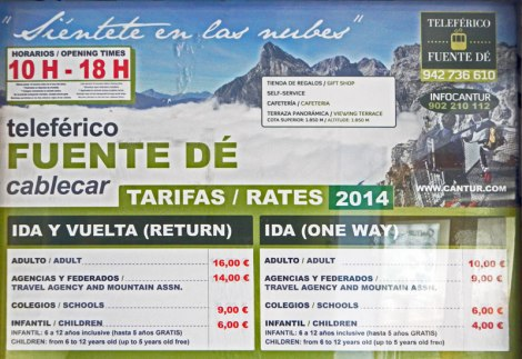 Sign showing rates for taking the cable car up and down the Picos de Europa