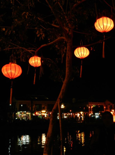 The light of the lanterns reflecting on the river in Hoi An, Vietnam