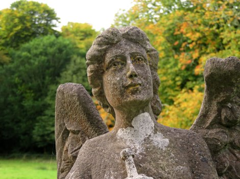 An angel guards a tomb in the cemetery at Muckross Abbey in Killarney National Park