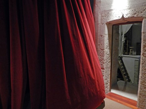 Red velvet curtains add a certain luxury to Cuellar Castle in Spain.