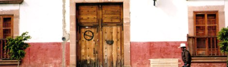 Traditional Patzcuaro-style wall with wood door and shuttered windows