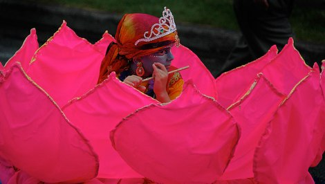 Hari Krishna parade with the child Krishna in a lotus blossom
