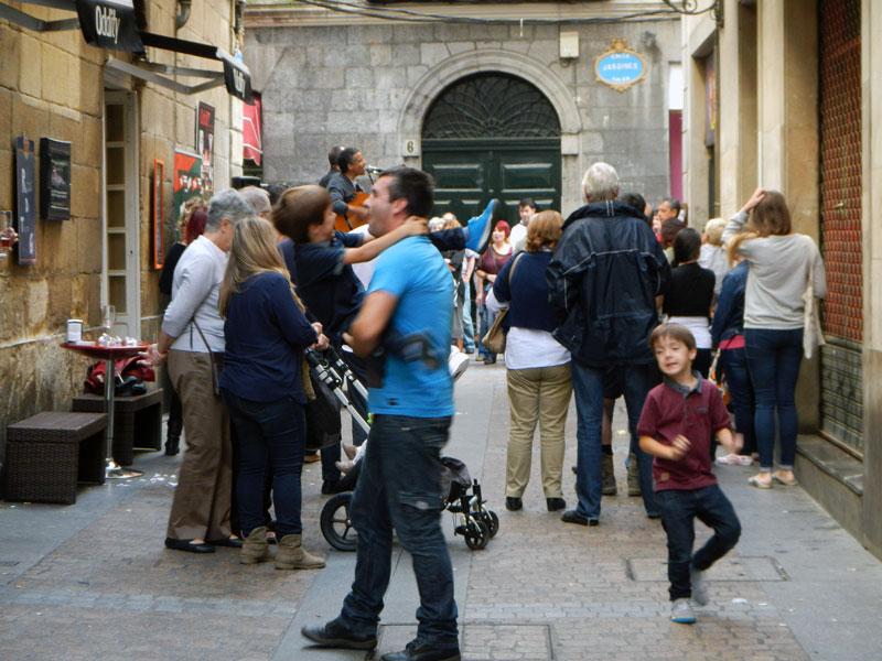 People dancing at the Bilbao street party on the 'Dia de Fiesta Nacional''
