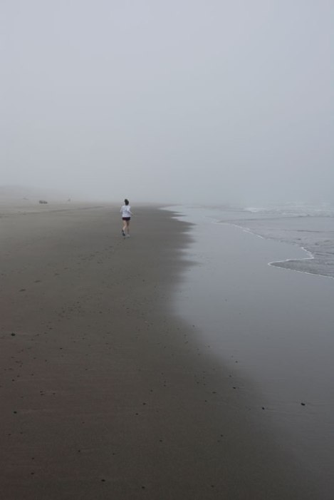 A runner on the beach in Oregon