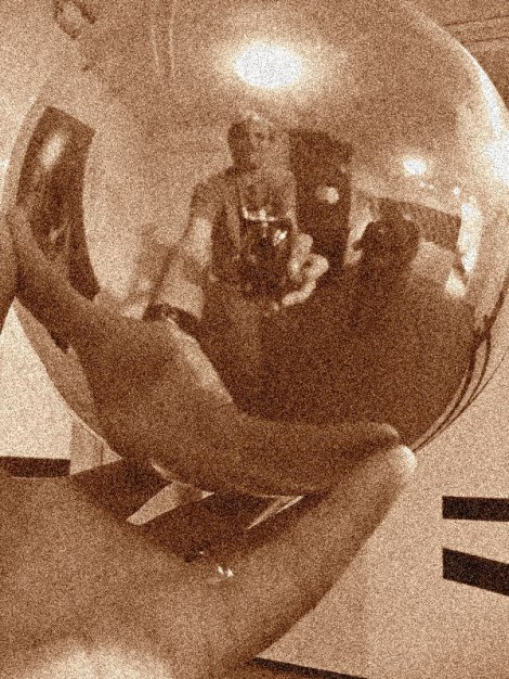 Recreating Escher's self portrait in a mirror ball with a selfie