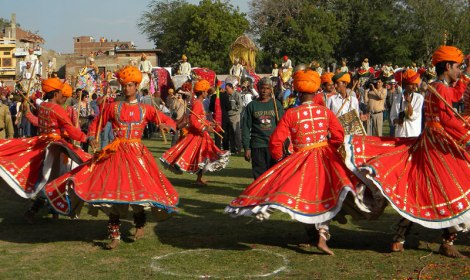 Male dancers with whirling skirts at the Jaipur Elefant Festival