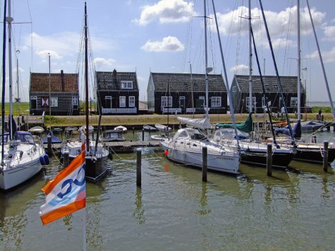 Boats and typical painted houses on Marken's waterfront (Holland)