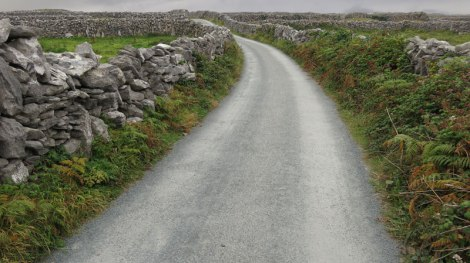 Stone fences line the road in the Aran Islands of Ireland
