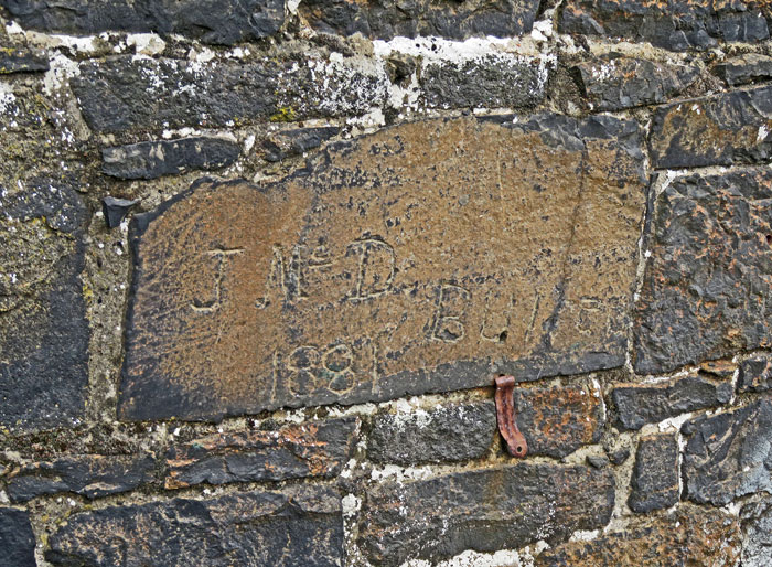 A grave in the exterior wall of Belfast's Crumlin Road Gaol