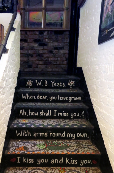 Belfast's Duke of York pub with a quote by W.B. Yeats on the stairs