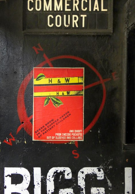 A poster on a Belfast wall showing the iconic yellow H & W crane