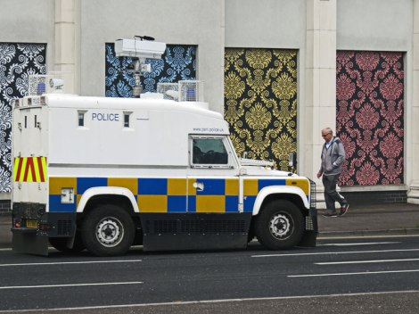 Belfast: Wallpapered Building and Policewagon