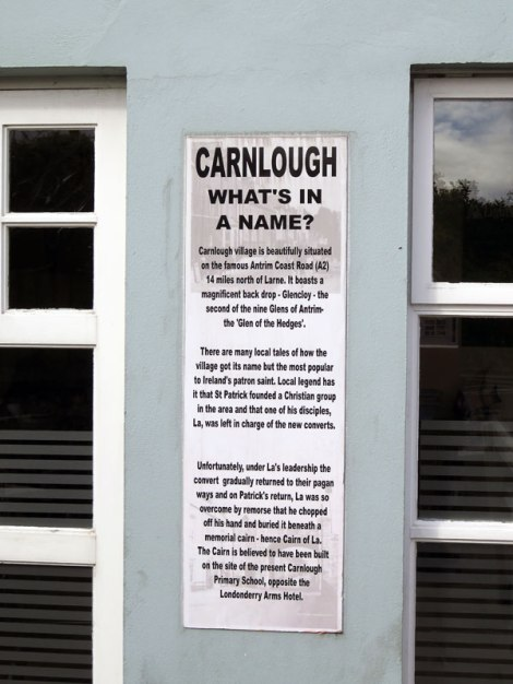 Sign explaining Carnlough, a small town on the Coastal Causeway route in Northern Ireland, UK